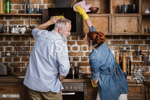 istock Mature couple in kitchen 667749004
