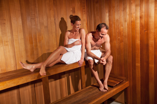 Mature Couple In Sauna Stock Photo - Download Image Now