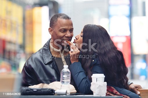 Mature couple in time square having lunch