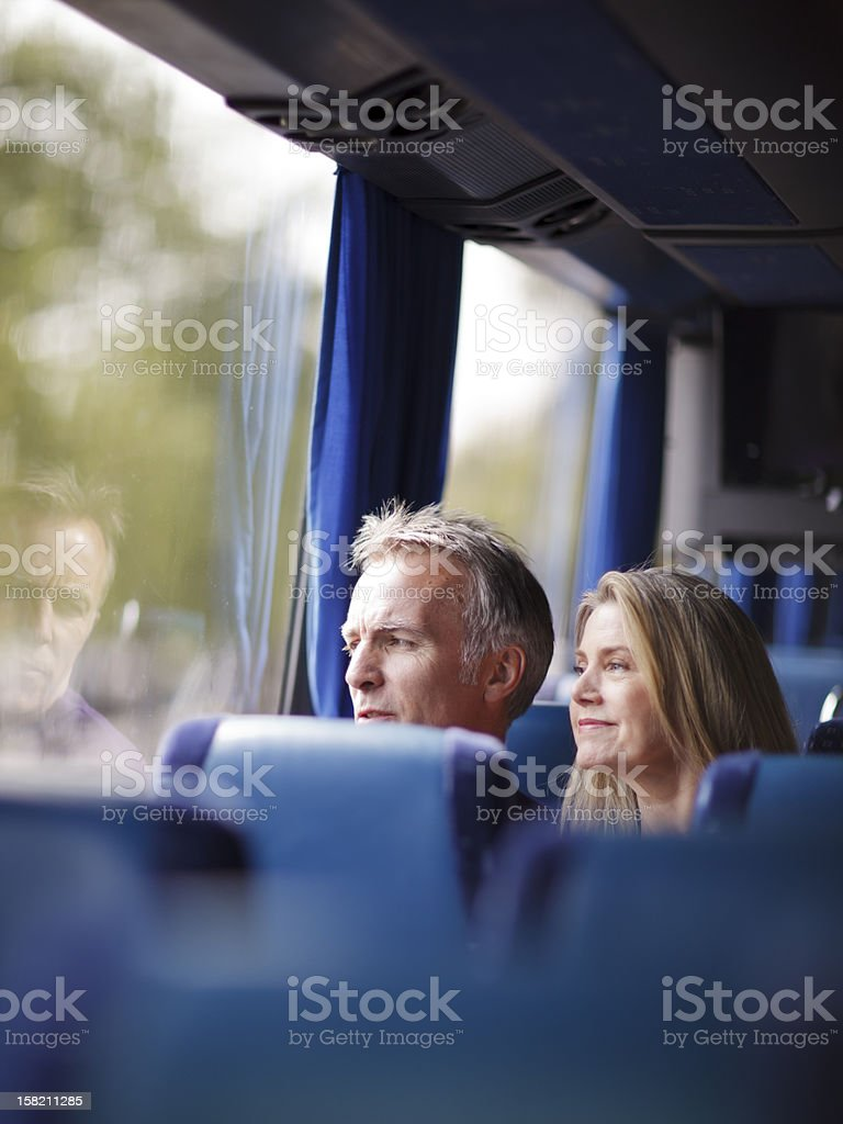 Mature couple inside a bus stock photo
