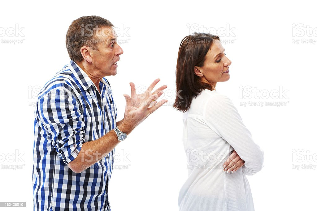 Mature couple isolated on white background arguing royalty-free stock photo