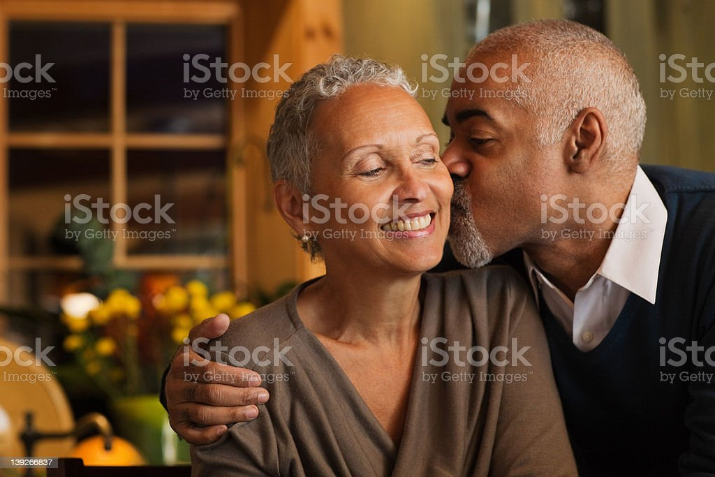 Mature couple kissing stock photo