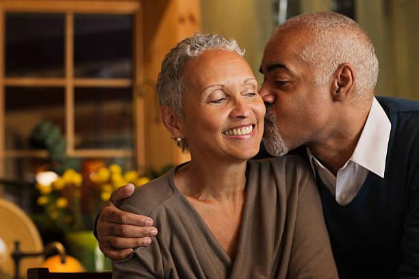 Mature couple kissing stock photo