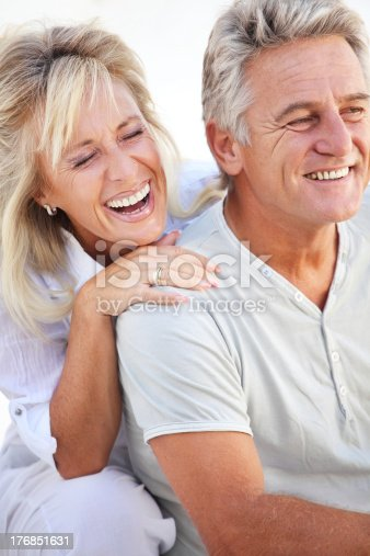 119998253istockphoto Mature couple laughing 176851631