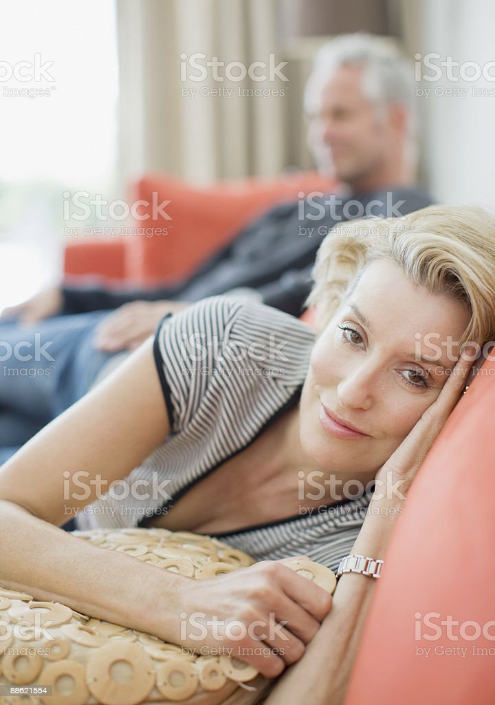 Mature couple laying on sofa royalty-free stock photo