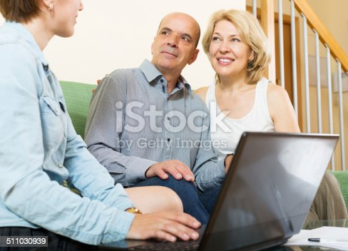 584597964 istock photo Mature couple listening female agent 511030939