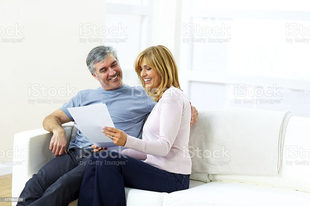 Mature couple looking at their monthly expenses royalty-free stock photo