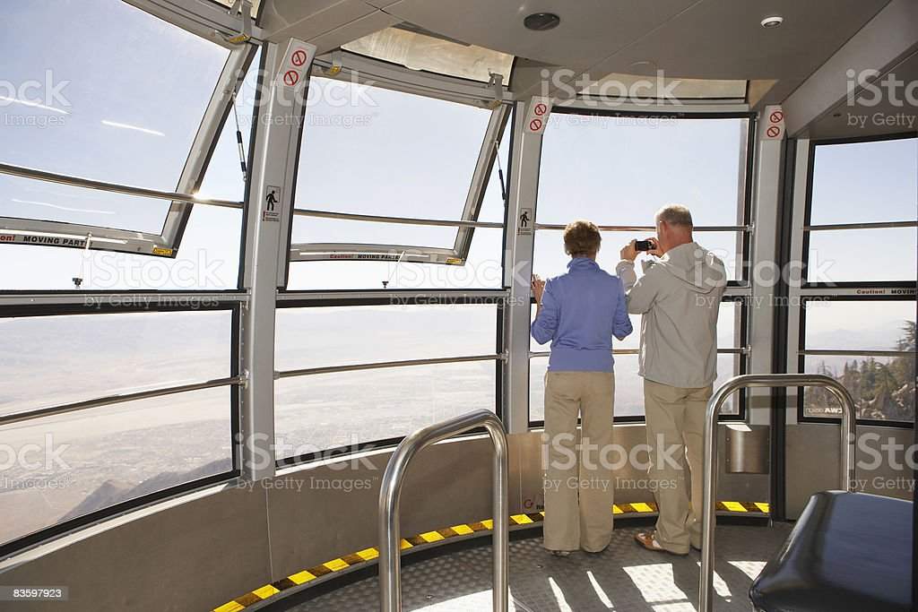 Mature Couple looking out window on tram royalty free stockfoto