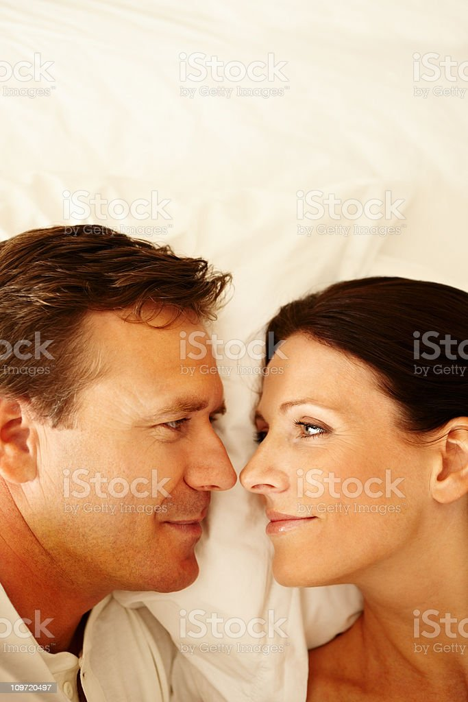 Mature couple lying on bed royalty-free stock photo