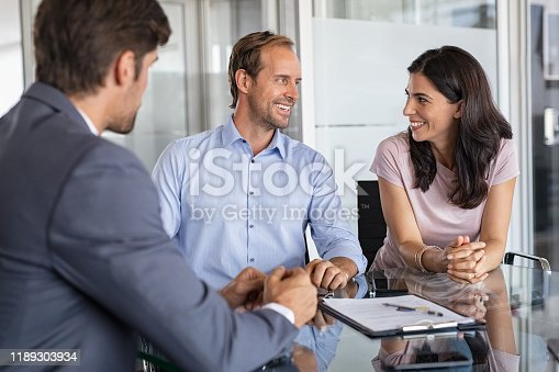 994164754 istock photo Mature couple meeting financial advisor 1189303934