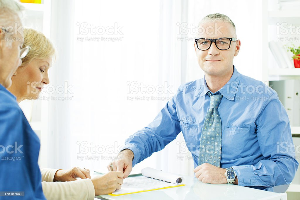 Mature Couple Meeting with Financial Advisor. royalty-free stock photo