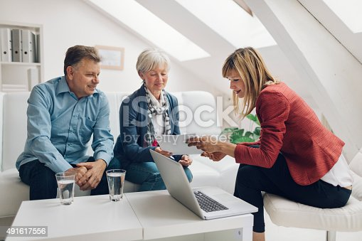 istock Mature Couple Meeting with Financial Advisor. 491617556