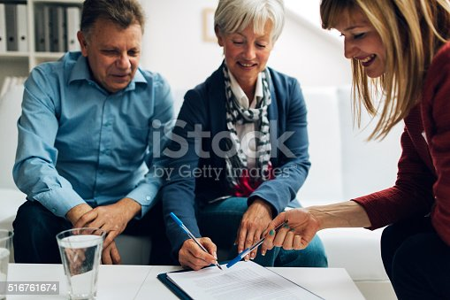 istock Mature Couple Meeting with Financial Advisor. 516761674