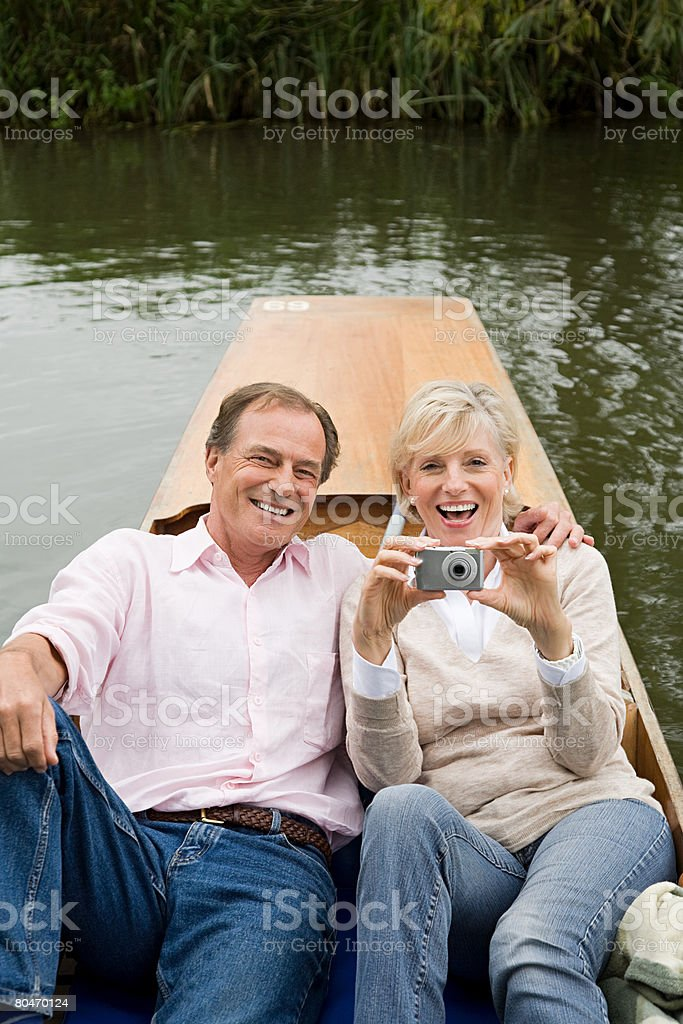 Mature couple on a boating trip 免版稅 stock photo