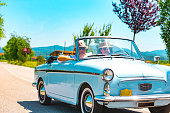 Mature Couple on a Road trip with a Vintage car