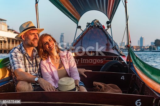 istock Mature Couple on a Romantic Sunset Boat Cruise on the River in Bangkok Thailand 654575496