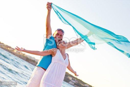 119998253 istock photo Mature couple on beach 532577961