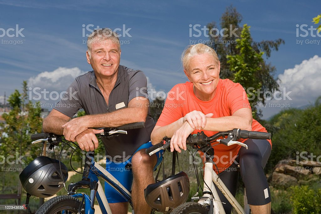 Mature couple on bicycles stock photo