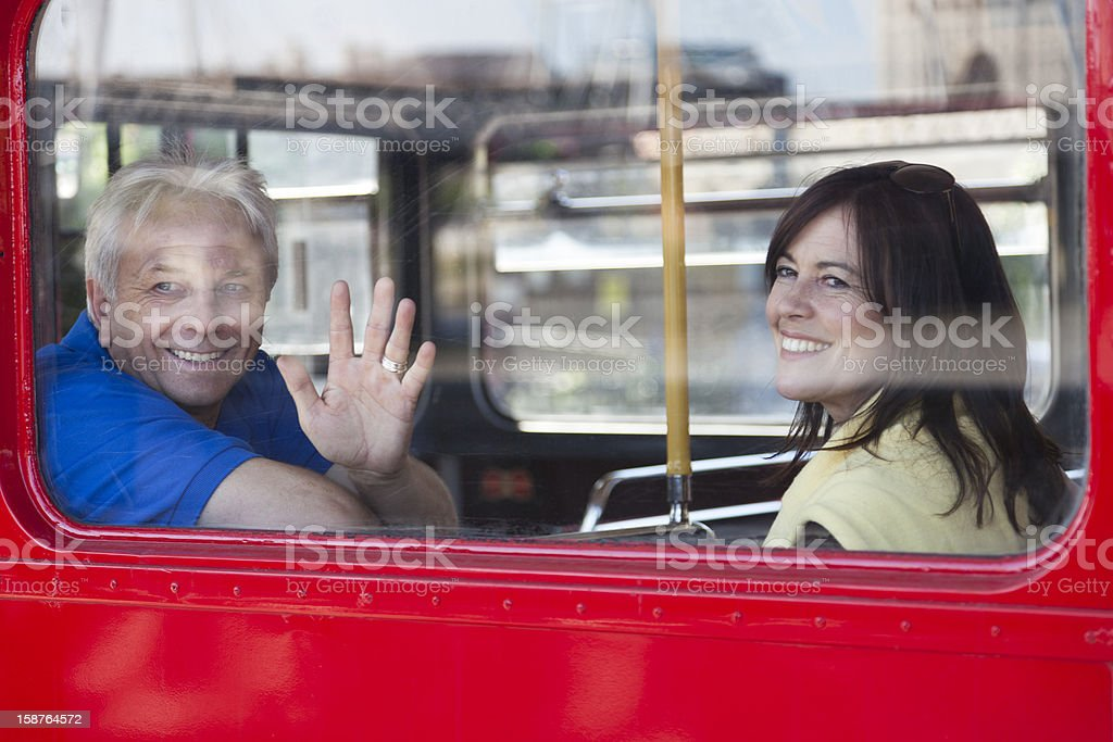 Mature Couple On Bus Looking Out Of Window And Smiling royalty-free stock photo