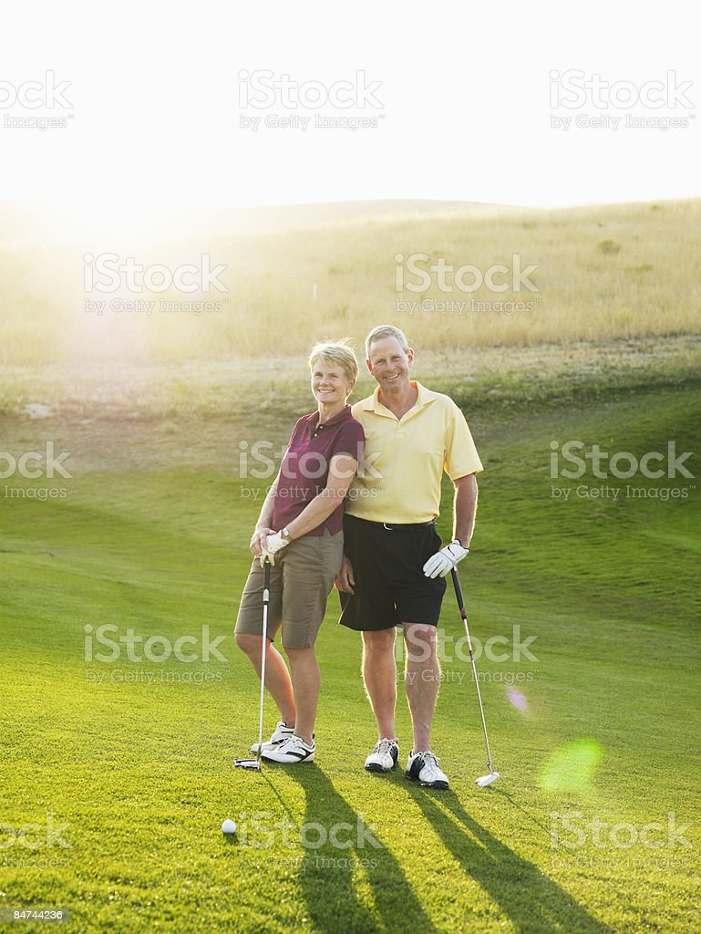 Mature couple on golf course royalty-free stock photo