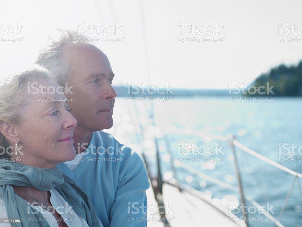 Mature couple on sailboat royalty-free stock photo