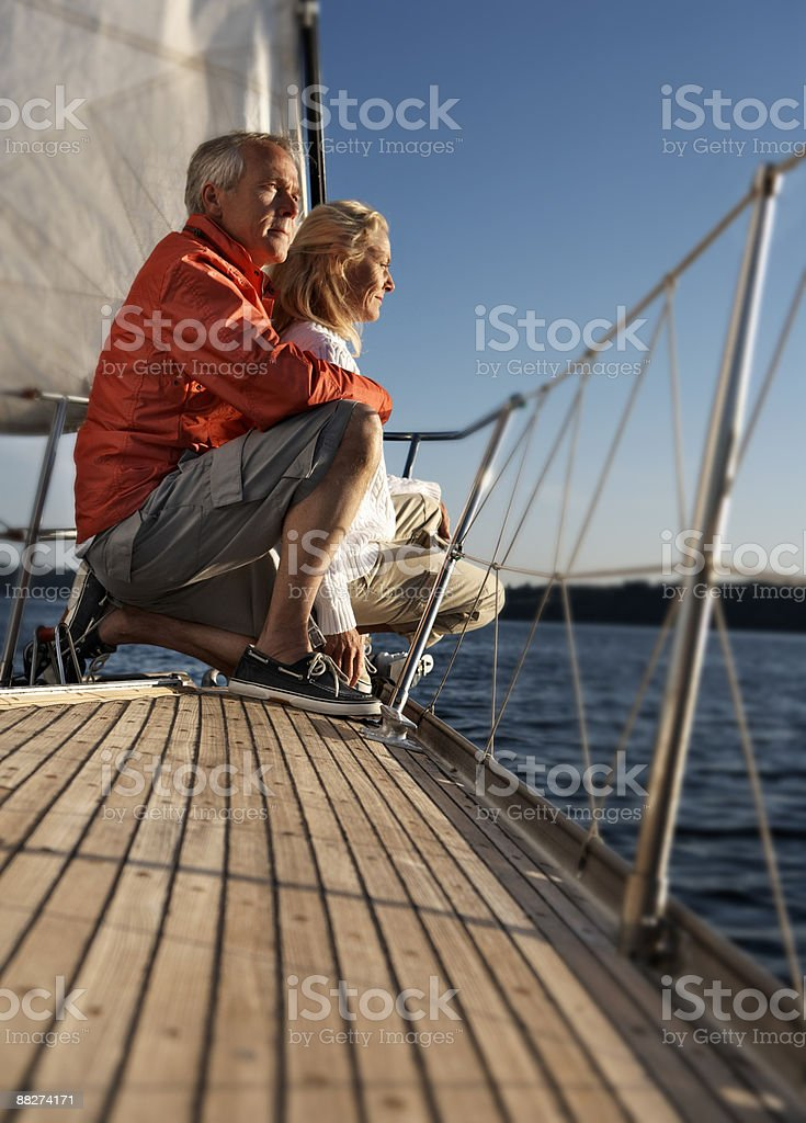Mature couple on sailboat royalty-free stock photo