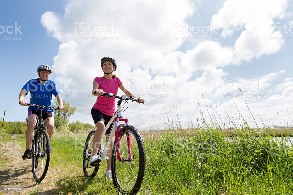 Mature couple outdoors on cycle ride stock photo