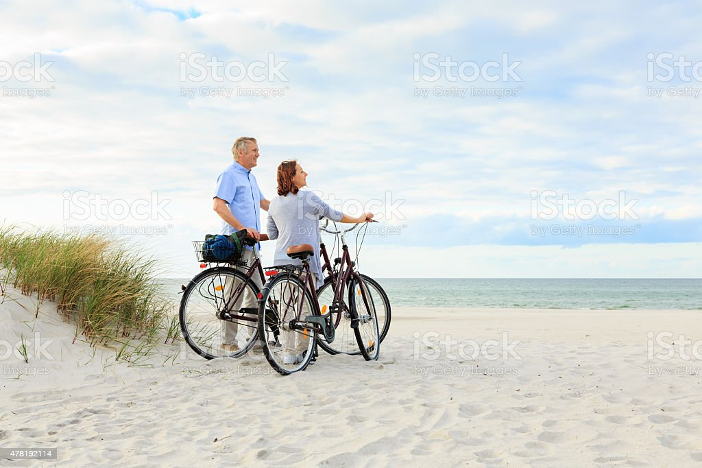 Mature couple outdoors on the beach stock photo