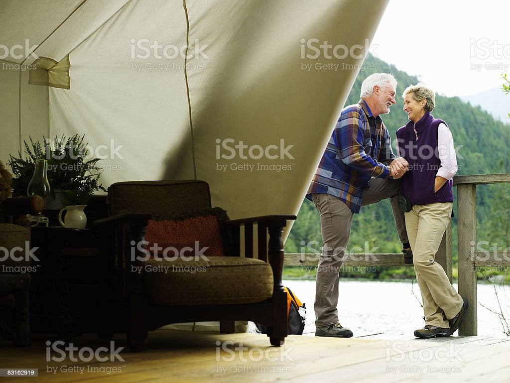 Mature couple outside of luxury tent. royalty-free stock photo