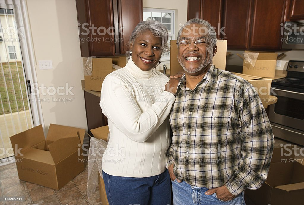 Mature couple packing. stock photo
