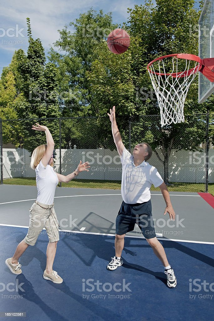 Mature Couple Playing Basketball stock photo