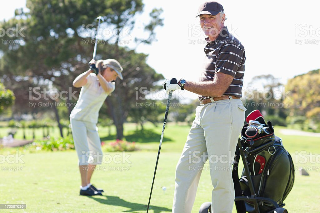 Mature couple playing golf royalty-free stock photo