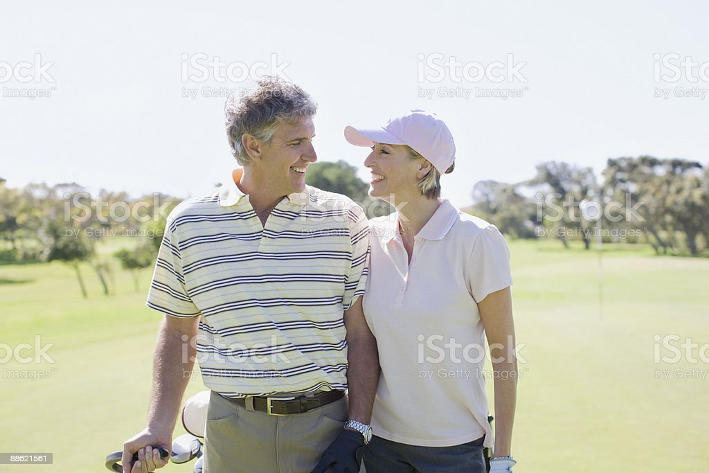 Mature couple playing golf together royalty-free stock photo