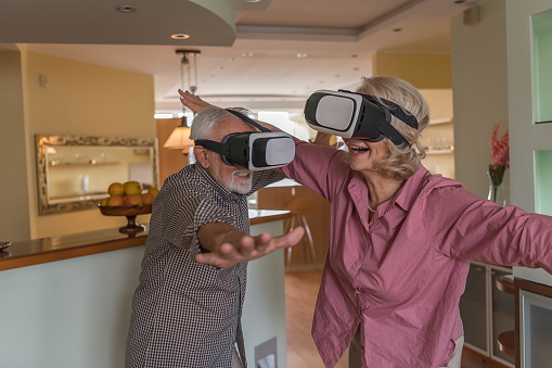 istock Mature Couple Playing Virtual Reality Games 1254251010