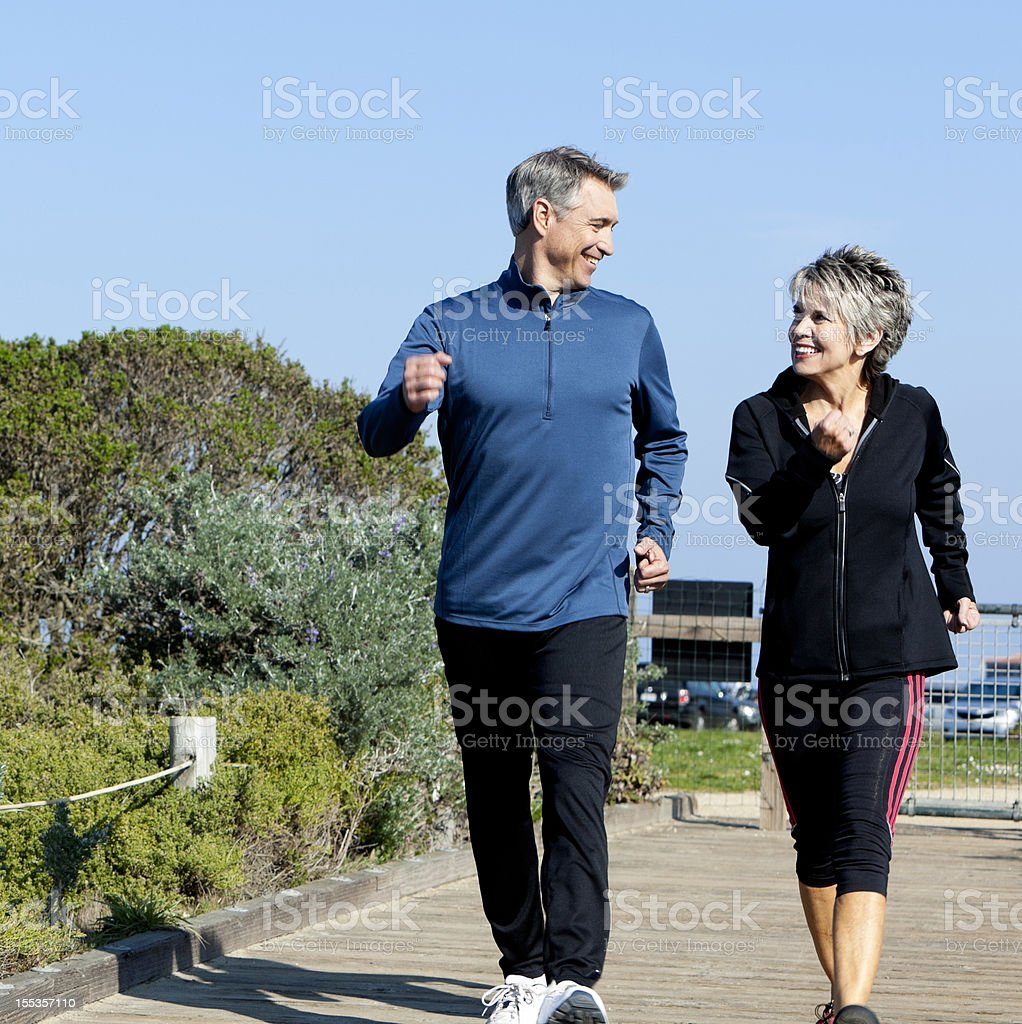 mature couple power walking royalty-free stock photo