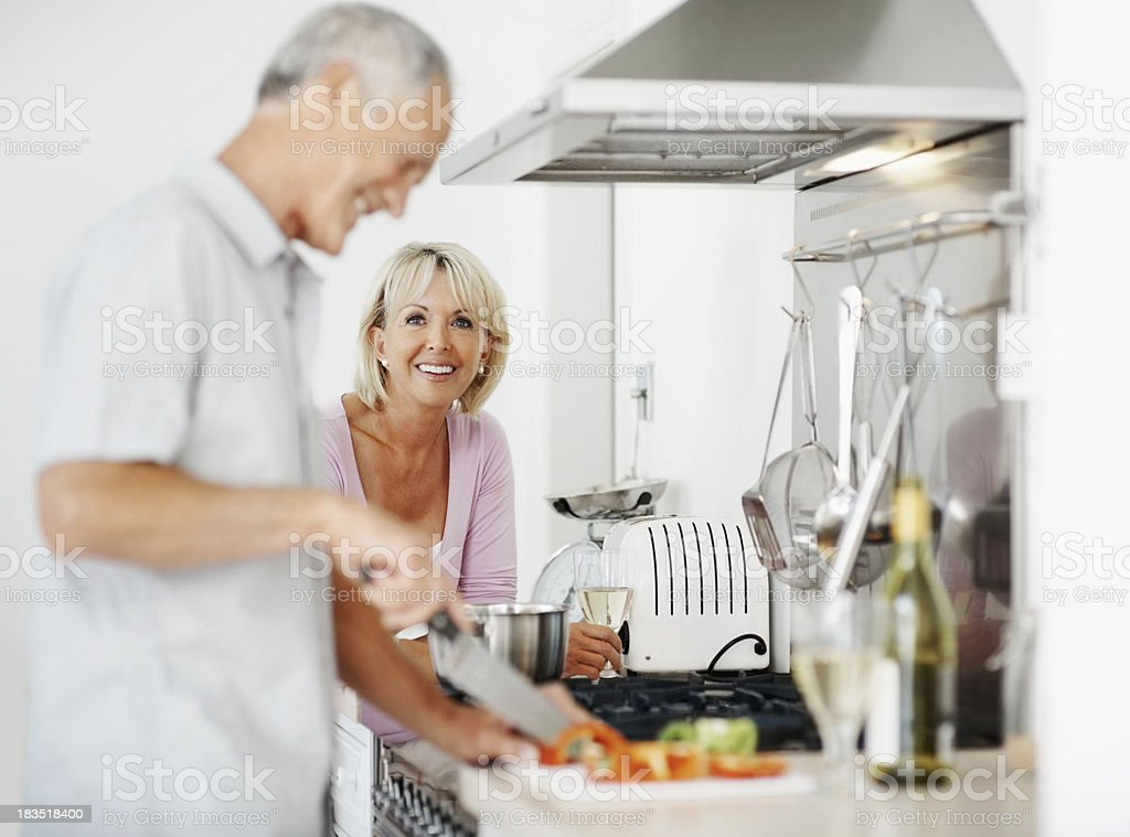 Mature couple preparing food at home royalty-free stock photo