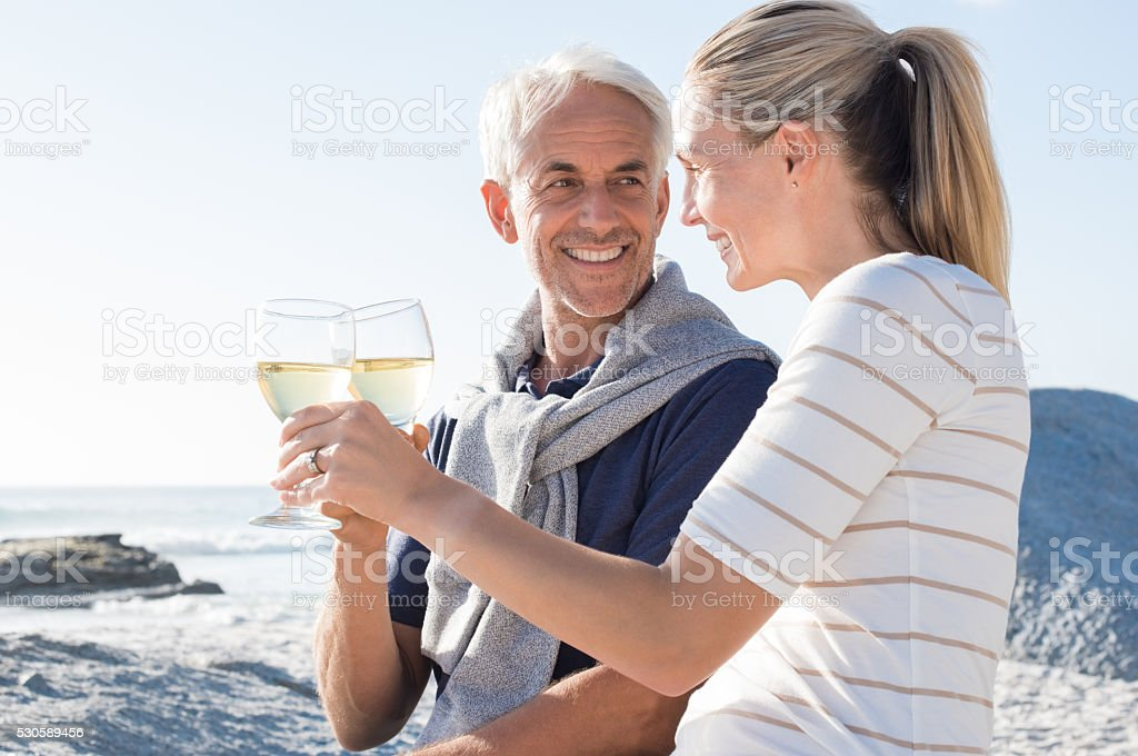 Mature couple raising toast stock photo