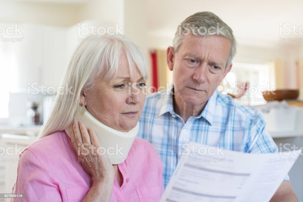 Mature Couple Reading Letter About Wife's Injury stock photo