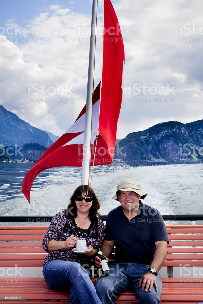 Mature couple relaxing on a lake cruise stock photo