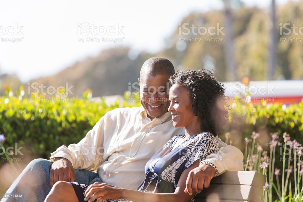 Mature Couple Relaxing on a Park Bench stock photo