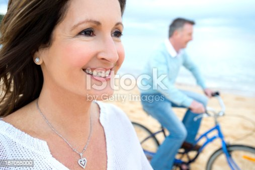 istock Mature couple riding bicycles 187055000