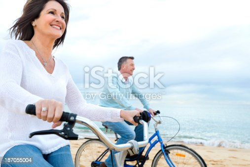 istock Mature couple riding bicycles 187055004
