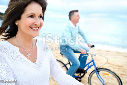 istock Mature couple riding bicycles 187055010