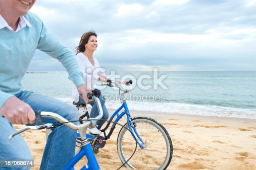 istock Mature couple riding bicycles 187068674
