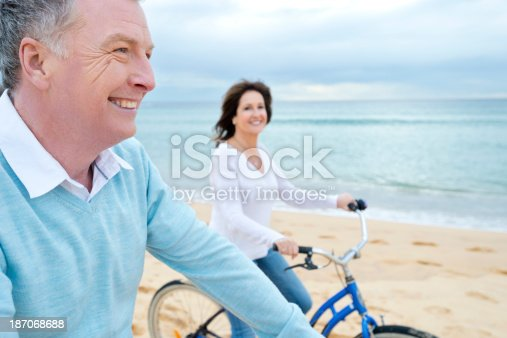 istock Mature couple riding bicycles 187068688