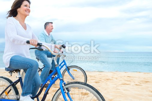 istock Mature couple riding bicycles 450094375