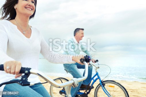 istock Mature couple riding bicycles 481384047