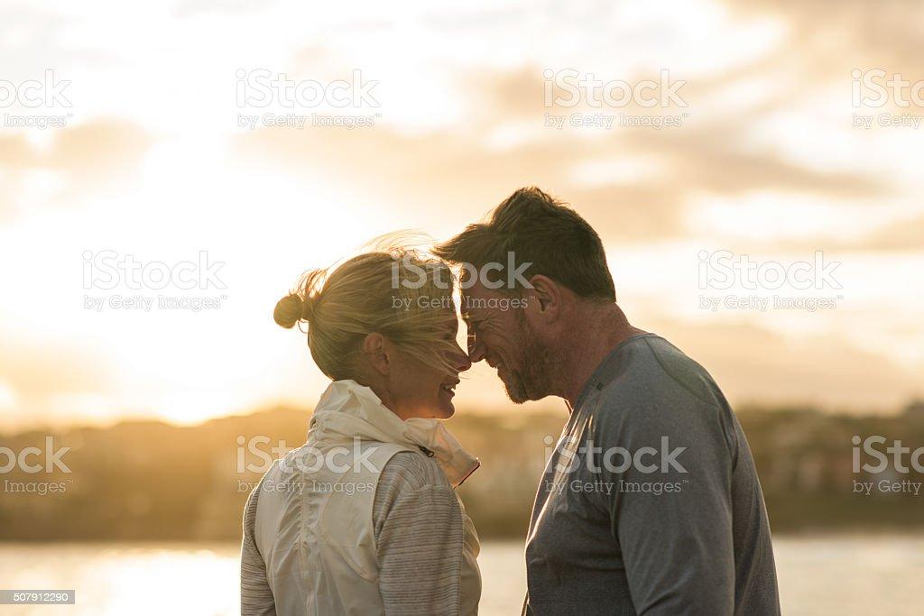 Mature couple romantic embrace Sydney Australia stock photo