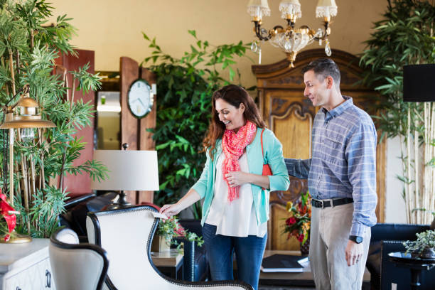 mature couple shopping in furniture store - furniture shopping stock photos and pictures
