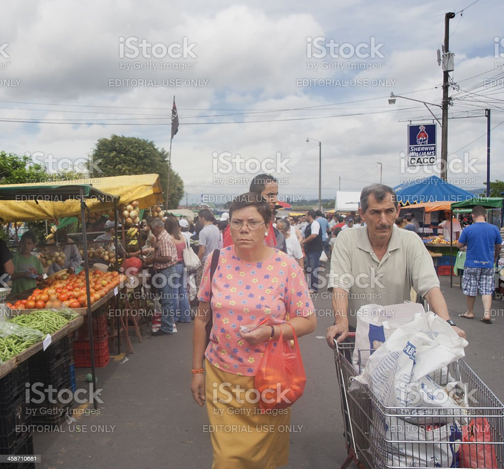 Mature couple shopping on market in San Jose, Costa Rica royalty-free stock photo